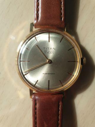 reloj titan cuerda nuevo 33,5mm tapado en oro