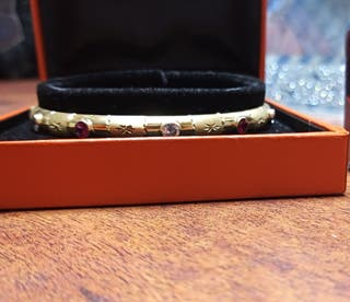 pulsera de oro con circonitas de semanario