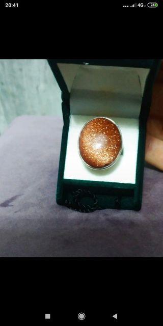 anillo de plata y piedra de sol
