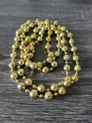 Collar largo de perlas doradas